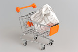 Shopping cart with gift box on gray