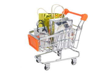 Shopping cart with packages isolated on white