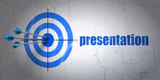 Marketing concept: target and Presentation on wall background