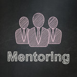 Education concept: Business People and Mentoring on chalkboard