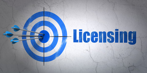 Law concept: target and Licensing on wall background