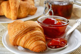 breakfast with fresh croissants and apricot jam