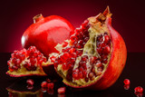 red pomegranate fruits on a dark background