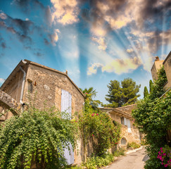 Sunset sky over ancient medieval buildings in Provence - France