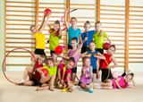 Group of little happy gymnasts