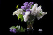 purple and white lilac in glass vase