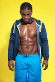 Athletic swimmer with waterdrops. Black man in sportswear fashio