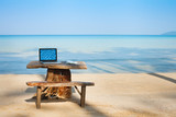 office on the beach, computer and table