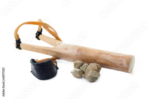 wooden slingshot and stones bullets isolated on white background