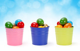 Colorful tin pails with Easter eggs