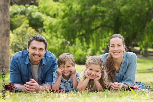 canvas print picture Portrait of parents and kids lying at park