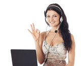 woman with laptop and headset showing ok sign