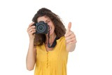Female photographer gesturing thumbs up