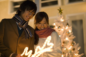 couple looking at illumination of Christmas