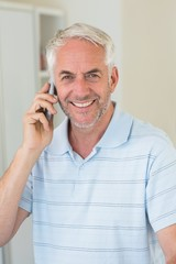 Smiling man on a phone call looking at camera