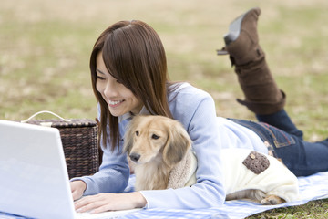 woman using PC with dog