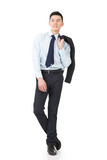 Young Asian businessman hold coat