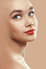 Closeup beauty portrait of attractive model face with bright mak