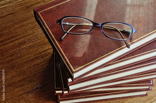 stack of books and glasses top view