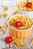 uncooked pasta and cherry tomatoes