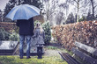 Man with little girl visiting graveyard of deceased wife