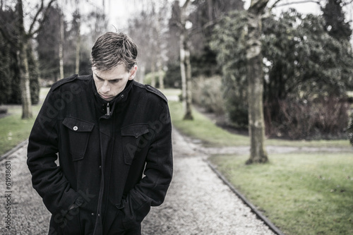 Lonely upset or depressed man outdoors