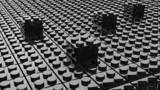 Black lego background with four blocks standing out