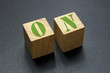 wood blocks with on word on black background