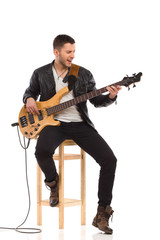Singing guitarist with bass guitar.