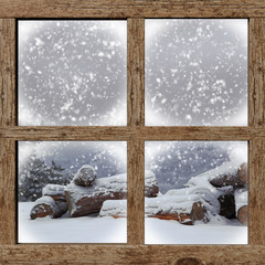 Winter outdoors view with firewood pile from wooden window