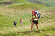 Young people are hiking in Carpathian mountains in summertime