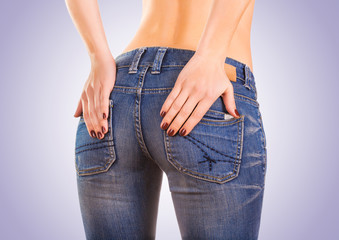 sexy woman buttocks in blue jeans on the blue