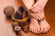 brown manicure and pedicure on the white