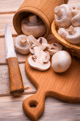 Fresh sliced champignon on the cutting board