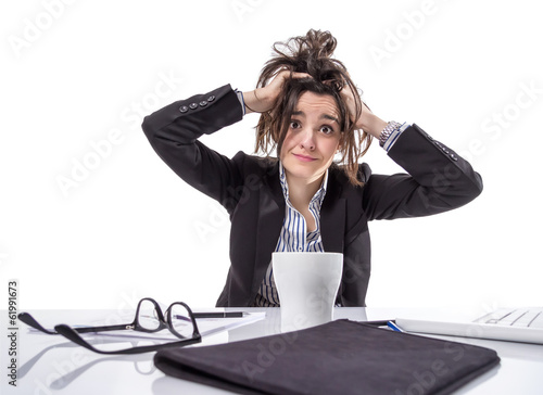 Stressed business woman pulling her hair