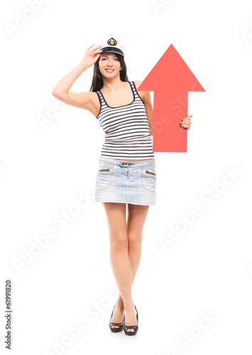 A sexy sailor girl with a red arrow isolated on white
