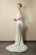 Full length portrait of a beautiful bride holding bouquet