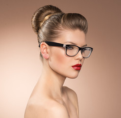 Beauty portrait of fashion girl in eyewear with retro red lips