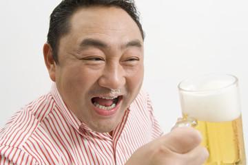 man drinking draft beer