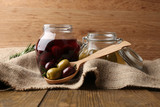 Tasty olives on wooden table