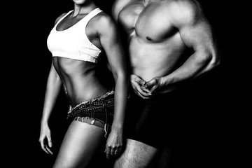 Strong woman and man against a black background © Nobilior