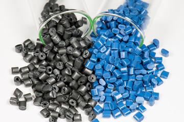 .blue and black polymer pellets in test tubes