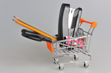 Shopping cart and stationery within on gray