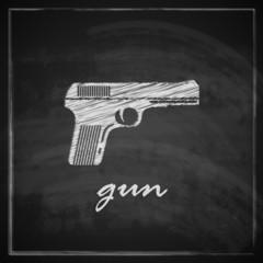 vintage illustration with gun on blackboard background.