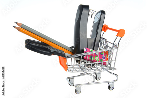 Shopping cart and stationery within isolated on white