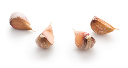 Garlic cloves on white background