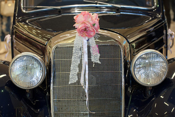 Vintage car with wedding bouquet