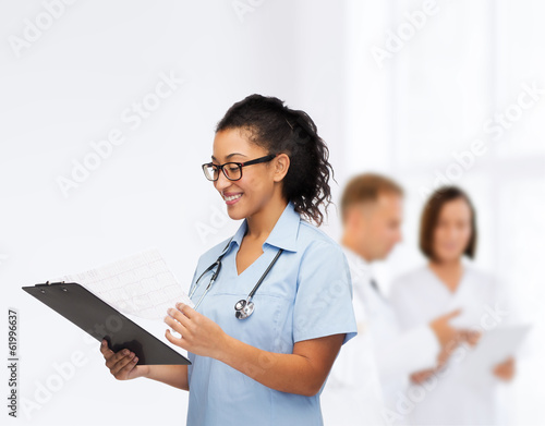 smiling female african american doctor or nurse