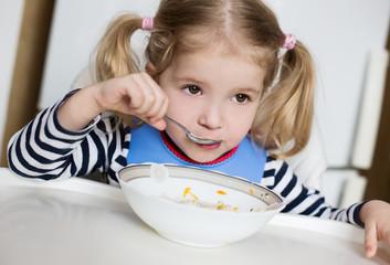 little girl eating soup