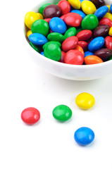 A bowl of colorful different sugary snacks